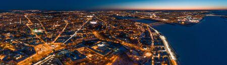 Aerial panoramic view of Nizhny Novgorod, Russia, illuminated at night. The Spit (confluence of Oka and Volga Rivers) and the Nizhny Novgorod Kremlin.
