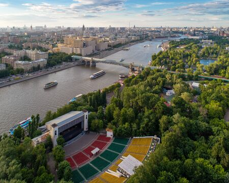 Aerial view of outdoor amphitheater of Green Theatre, main building of the Ministry of Defence of Russian Federation, Pushkinsky (Andreevsky) bridge over Moskva-river and Gorky park at summer, Moscow, Russia