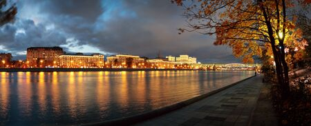 Panorama of the pedestrian embankment at Neskuchny garden and Moskva-river at autumn night, Moscow, Russia