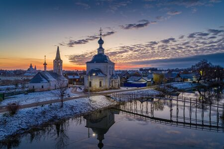 Russian Town Suzdal at sunset. Church of the Epiphany and the bridge over the Kamenka river  the beauty of the Russian province.