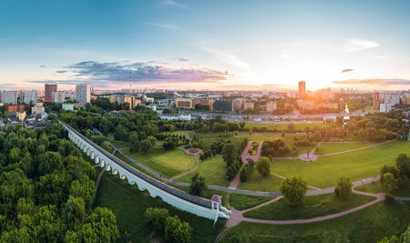 Aerial view of Moscow over the Rostokino Aqueduct (Millionny Bridge) and the park around it at summer sunset. There are distant VDNKh park and Ostankino tower Фото со стока