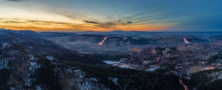 Aerial panoramic view of Zakopane and Tatry mountains at sunset, Poland Фото со стока