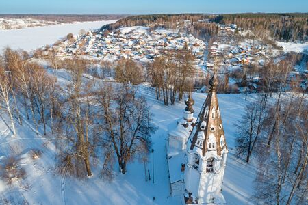 Town of Plyos on the banks of the Volga river, Russia. Aerial winter view on the Uspensky Sobor, the Cathedral mountain and the distant town Фото со стока