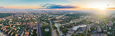 Aerial view of Moscow over the VDNKh and Cosmos hotel at summer sunset. There are distant Ostankino tower and Moscow City business center skyscrapers Imagens