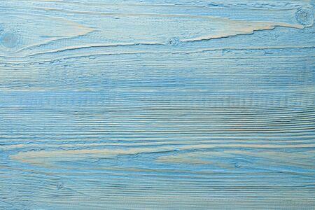Painted light blue textured wooden backgound