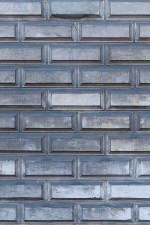 Industrial grey brick wall vertical background