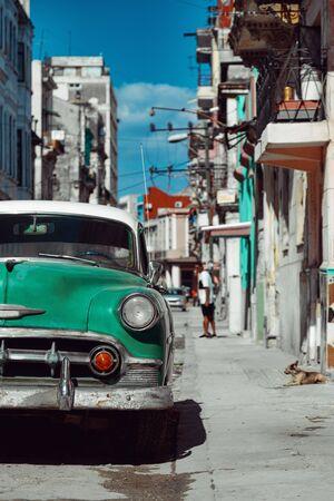 Green retro car parked on the street of Havana, Cuba