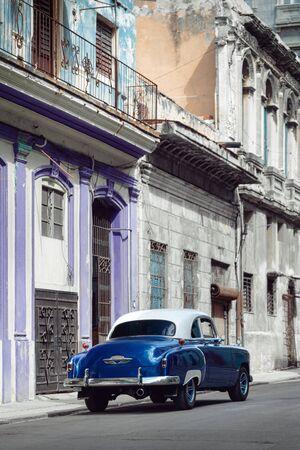 Shiny blue retro car parked on the street of Havana, Cuba