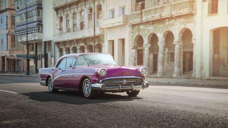 Pink retro car on the street of Havana, Cuba, shot with panning