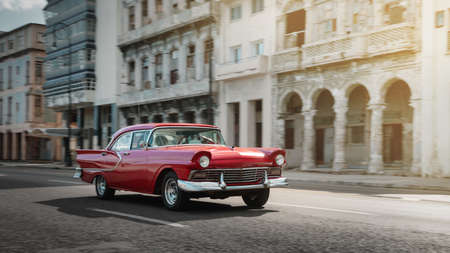 Red retro car on the street of Havana, Cuba, shot with panning