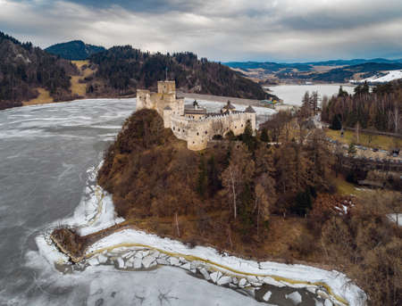Aerial view of the Niedzica Castle (or Dunajec Castle) by the lake Czorsztyn, Poland, at early spring Editorial
