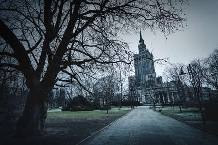 View of the palace of Culture and Science in Warsaw and nearby park on a cloudy day