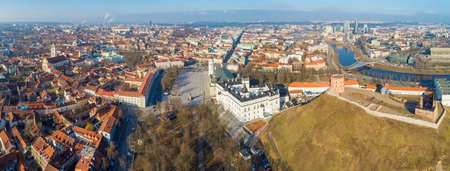 Aerial panoramic view of old town and  modern part of Vilnius, Gediminas Tower on the hill is on foreground, Lithuania Editorial