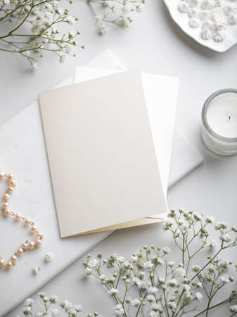White wedding stationery flat lay with blank greeting card Imagens