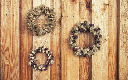 flower wreath on wooden rustic background