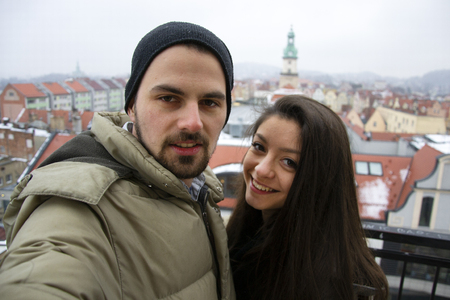 love couple smile to camera at winter with snow in Germany