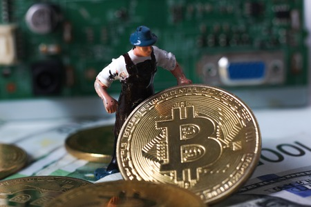 A little miner is digging on golden bitcoin with dollar and graph background. conceptual image of bitcoin mining and trading.