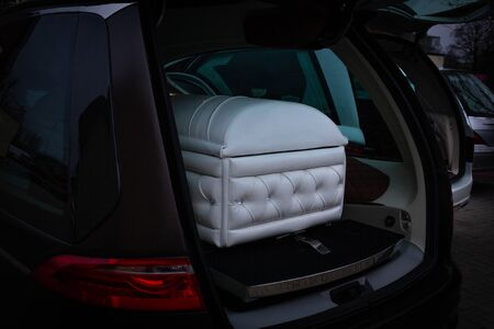 Funeral home with new modern like retro Chesterfield in car Фото со стока