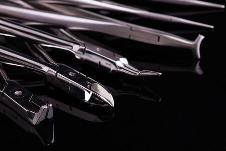 Metal Dental equipment on black background Stok Fotoğraf