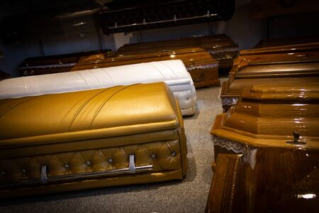 Gold Coffin with new modern like a Sofa chester style. Funeral home.