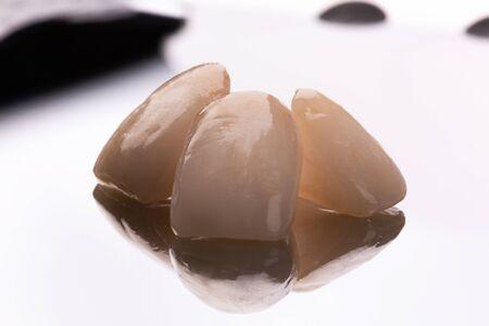 Ceramic veneers on mirror background. Dentistry teeth concept