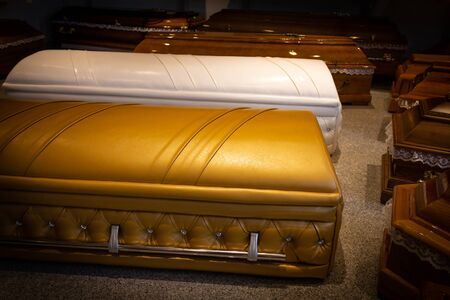 Gold Coffin with new modern like a Sofa chester style.