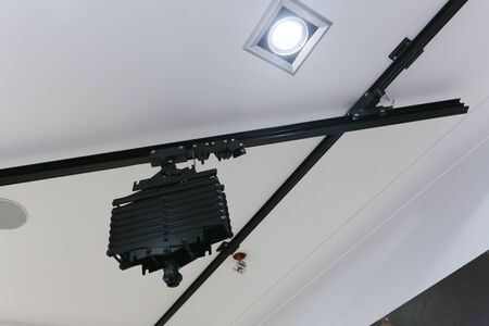 fixture for studio light on the ceiling. Studio light on the ceiling with lamps Imagens