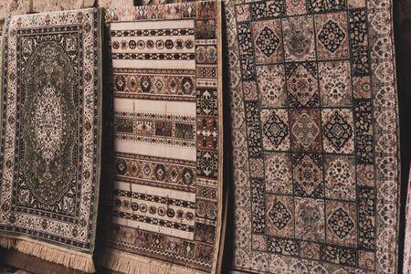 Vintage patchwork background on retro handmade carpet. Patterns on texture of old blanket surface. Imagens