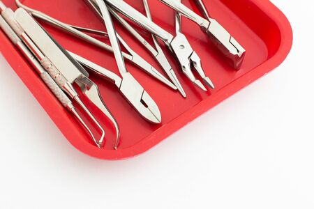 Dentist tools in red box with white color as a background isolated.
