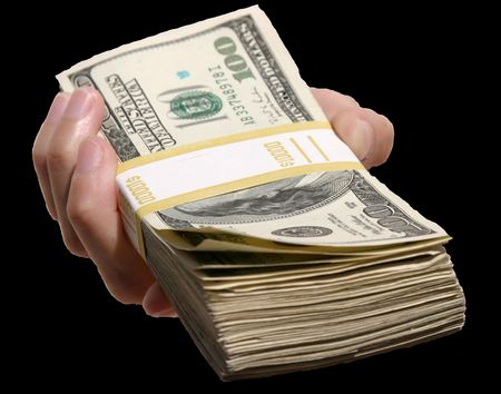 end user: A human hand isolated against a black background holds a pile of cash for YOU the end user!