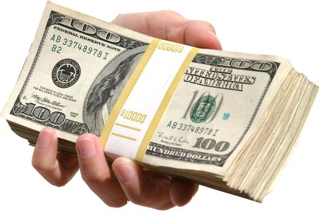 end user: A human hand isolated against a white background holds a pile of cash for YOU the end user!
