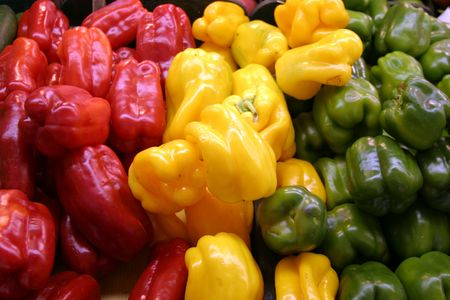 red,yellow,and green bell pepper for sale at a farmers market photo