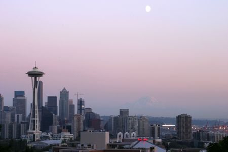 seattle at sunset with the moon and mt raineer photo