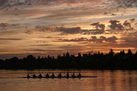 rowing in green lake at sunrise