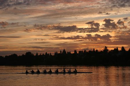 rowing in green lake at sunrise