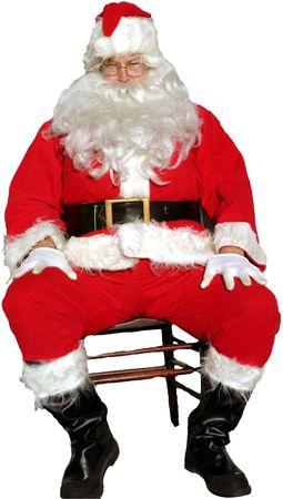 Santa Claus sits in a chair