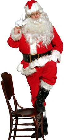 isolated santa holds one finger up in the air as if to say  Imagens
