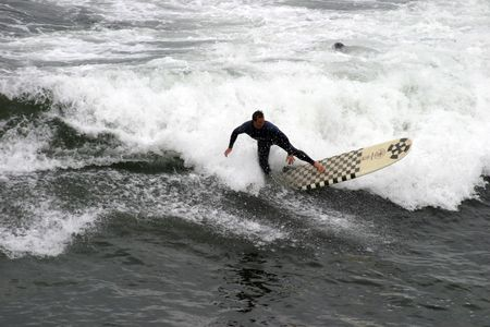 a surfer rides the waves photo