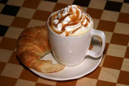 Caramel latte with croissant photo