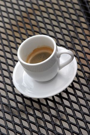 expresso: a cup and saucer of expresso