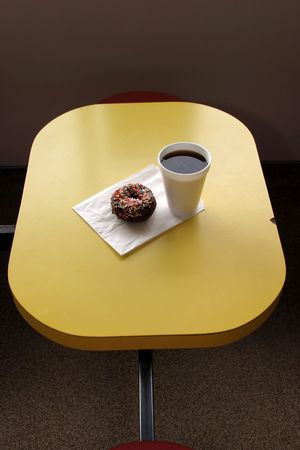 donut and coffee on yellow table
