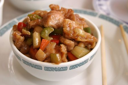 pow: A Bowl of Kung Pow Chicken  in a chinese resturant