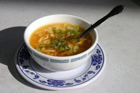 resturant: egg flower soup with a spoon in a chinese resturant Stock Photo
