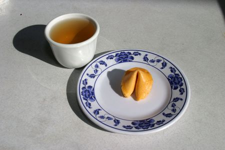 resturant: fortune cookie with green tea in a chinese resturant