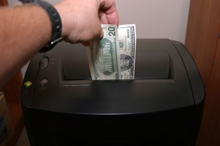 a human shredding money Stock Photo - 284937