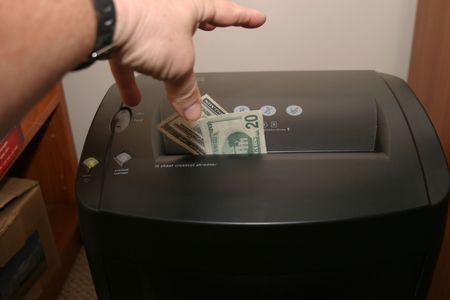 a human shredding money photo