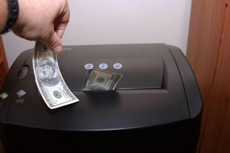 a human shredding money photo