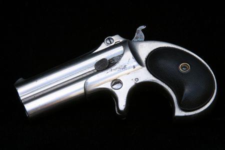 Circa 1889, Model 95, Type II Model 3 Double Derringer on black velvet Stock Photo - 295714