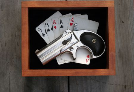 Circa 1889, Model 95, Type II Model 3 Double Derringer in wooden box  with aces and eights (aka a Dead Mans Hand) and ammo