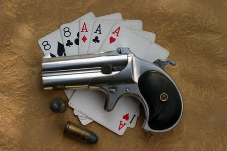 eights: Circa 1889, Model 95, Type II Model 3 Double Derringer on gold background with aces and eights (aka a Dead Mans Hand) and ammo